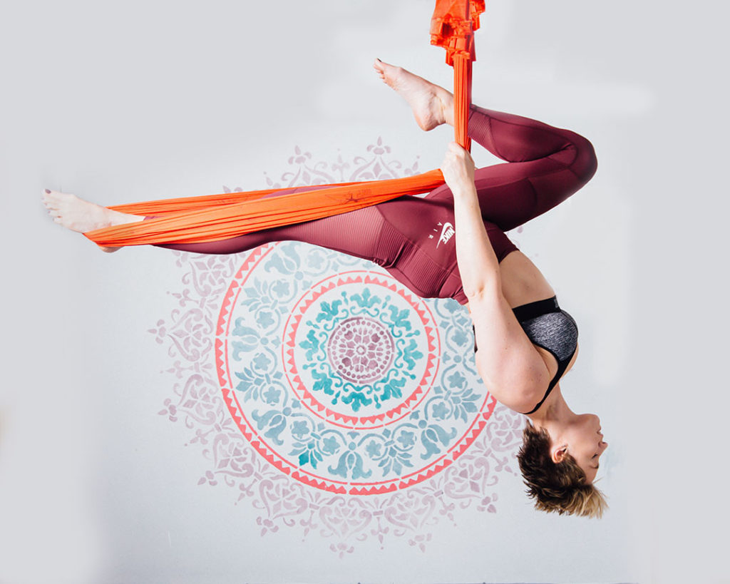 Anti-gravity yoga post gainst wall with mandala - Brand Photography