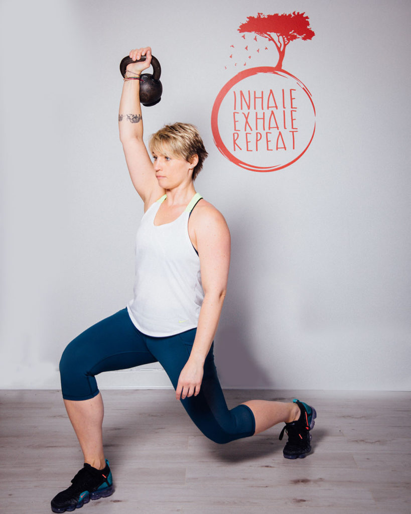 Anna doing a lounge pose with kettlebell - Brand Photography